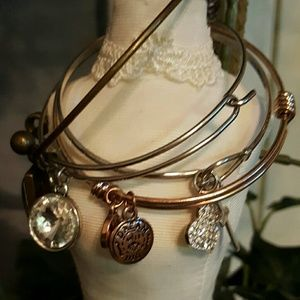 Jewelry - Bundle of four bangle bracelets with charms